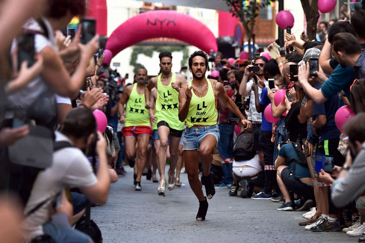 "Participants run during the ""High Heels Race"" as part of the WorldPride 2017 celebrations in Madrid on June 29, 2017. PHOTO: AFP"