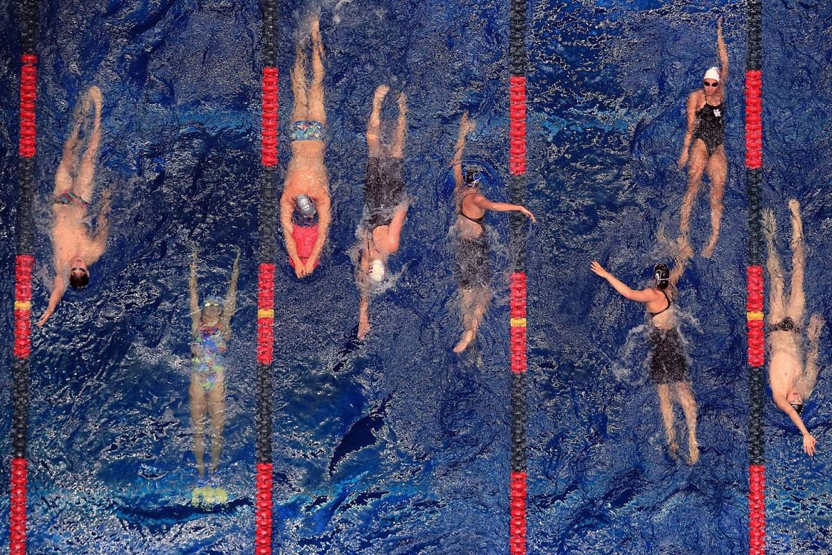 Swimmers warm up during the 2017 Phillips 66 National Championships & World Championship Trials at Indiana University Natatorium on June 29, 2017 in Indianapolis, Indiana. PHOTO: GETTY IMAGES/AFP