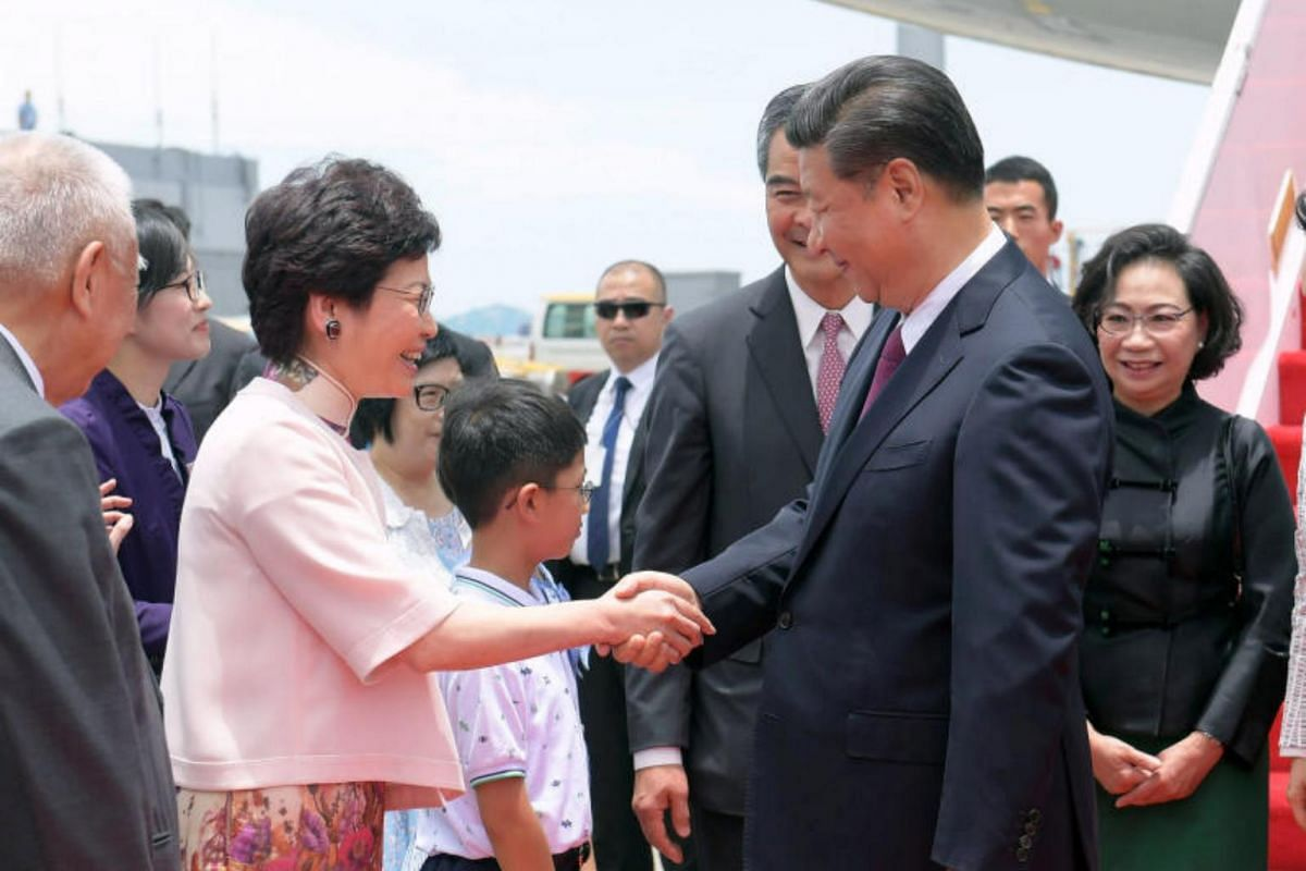 Chinese President Xi Jinping (right) is welcomed by Chief Executive-elect Carrie Lam upon Xi's arrival in Hong Kong, on June 29, 2017.