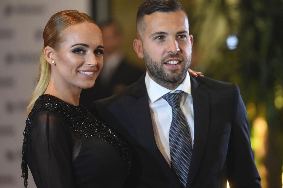 Barcelona's football player Jordi Alba and his wife posing on a red carpet during Barcelona's football star Lionel Messi and Antonella Roccuzzo wedding in Rosario, Santa Fe province, Argentina on June 30, 2017.