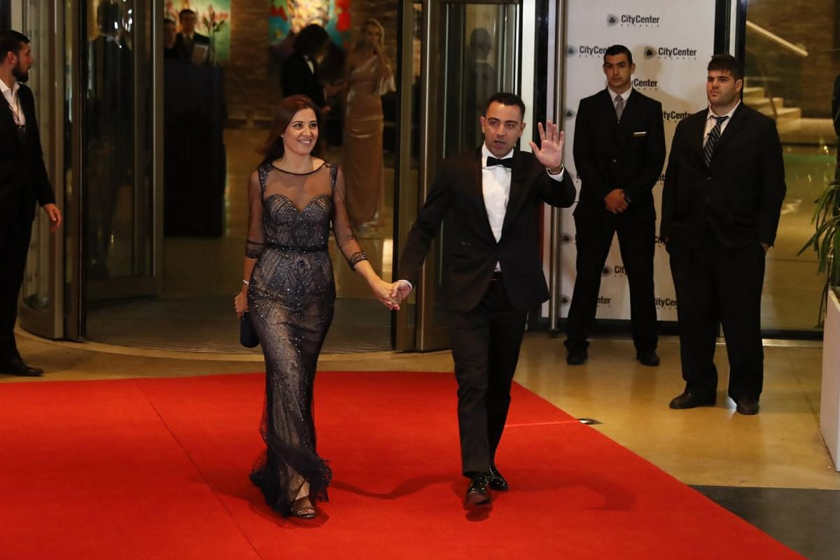 Spanish player Xavi Hernandez and his wife Nuria Cunillera posing as they arrive for the wedding of Argentinian soccer player Lionel Messi and Antonella Rocuzzo, in Rosario, Santa Fe, Argentina on June 30, 2017.