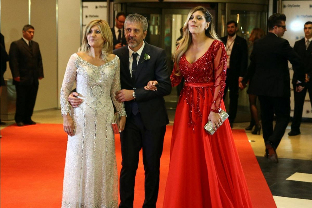 Argentine soccer player Lionel Messi's parents Jorge and Celia and his sister Maria Sol posing at his wedding to Antonela Roccuzzo in Rosario, Argentina on June 30, 2017.