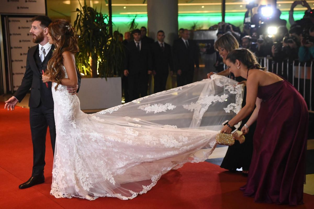 Argentine football star Lionel Messi and bride Antonella Roccuzzo posing for photographers just after their wedding at the City Centre Complex in Rosario, Santa Fe province, Argentina on June 30, 2017.