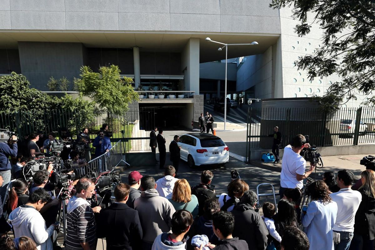 Journalists and bystanders gathering outside the hotel where the wedding of Argentina soccer player Lionel Messi and Antonela Roccuzzo will take place in Rosario, Argentina on June 30, 2017.
