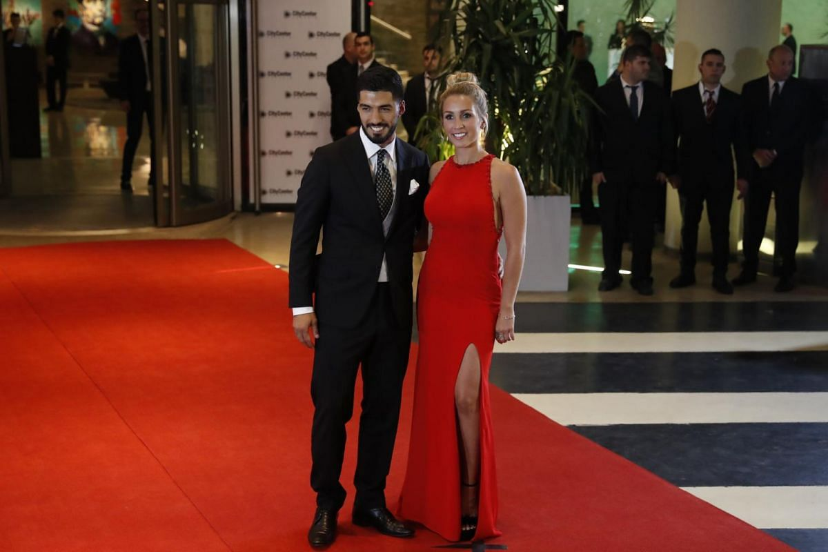 Uruguayan soccer player Luis Suarez and his wife Sofia Balbi attending the wedding of Argentinian soccer player Lionel Messi and Antonella Roccuzzo, in Rosario, Santa Fe, Argentina on June 30, 2017.