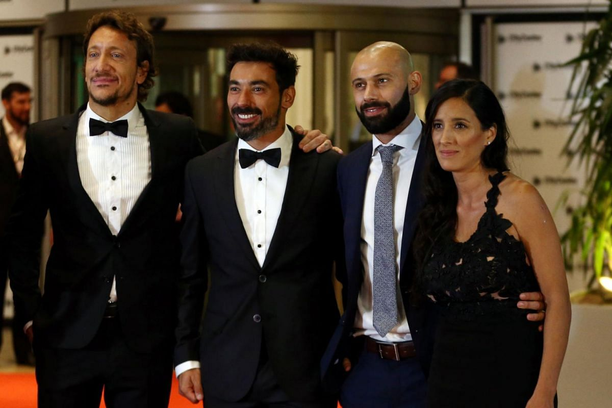 Actor Nicolas Vazquez and soccer players Ezequiel Lavezzi and Javier Mascherano and his wife Fernanda posing for photographers at the wedding in Rosario, Argentina on June 30, 2017.