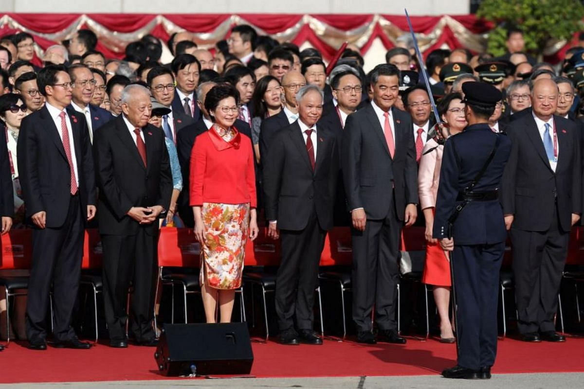 Hong Kong's first chief executive from 1997 to 2005, Tung Chee-hwa (second left), Hong Kong's incoming leader Carrie Lam (third, left) and Hong Kong's outgoing Chief Executive Leung Chun-ying (fifth, left) attending a flag-raising ceremony at Golden