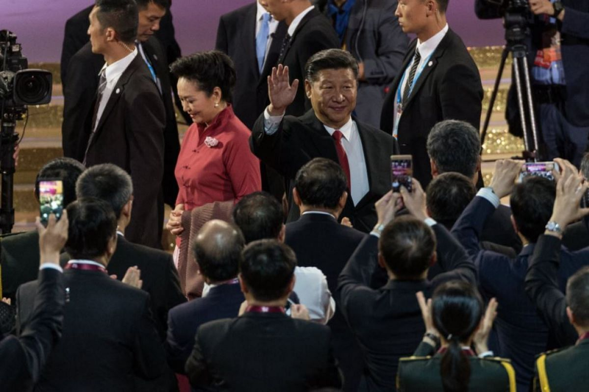 Chinese President Xi Jinping (centre,right), waving as he and Chinese First Lady Peng Liyuan (centre, left), arrive a grand variety show Hong Kong Exhibition and Convention Centre in Hong Kong, on June 29 2017.