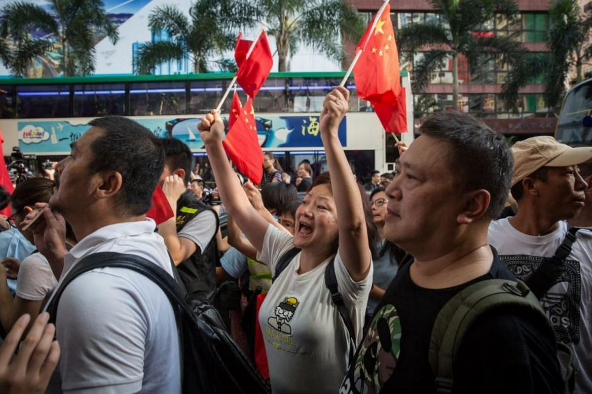Pro-Chinese activists blocking the pathway as democracy activists try to march during a pro-democracy protest in Hong Kong, on July 1, 2017.