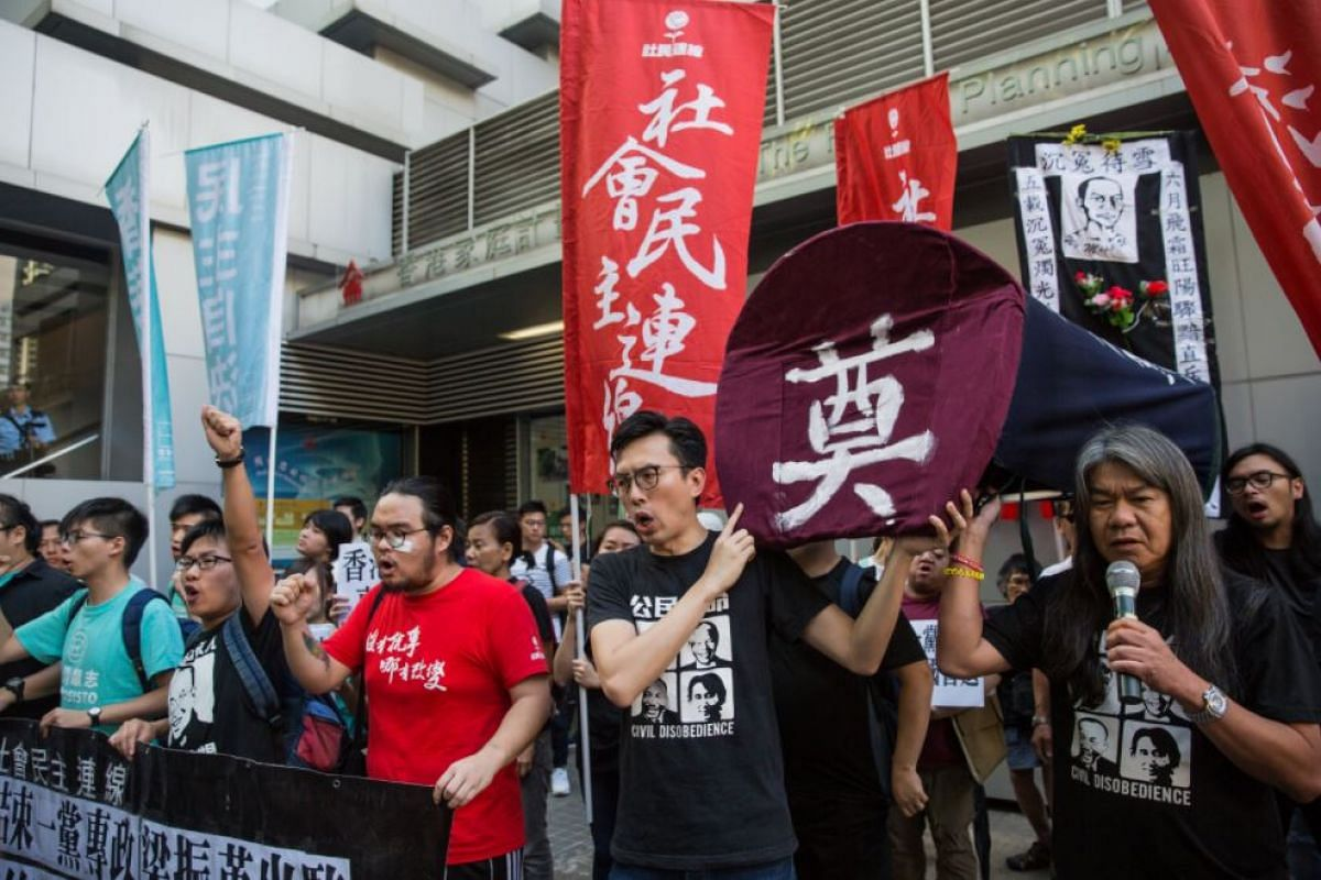 Democracy activists attending a pro-democracy protest in Hong Kong, China, on July 1, 2017.
