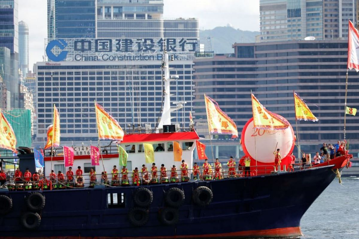 Performers sailing on a decorated ship near the area where ceremonies marking the 20th anniversary of the city's handover from British to Chinese rule are taking place, in Hong Kong, on July 1, 2017.