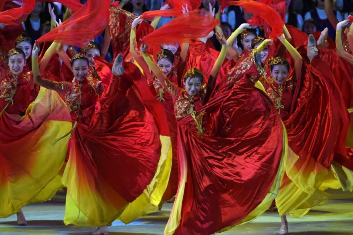 Performers dancing during a variety show attended by China's President Xi Jinping in Hong Kong on June 30, 2017.