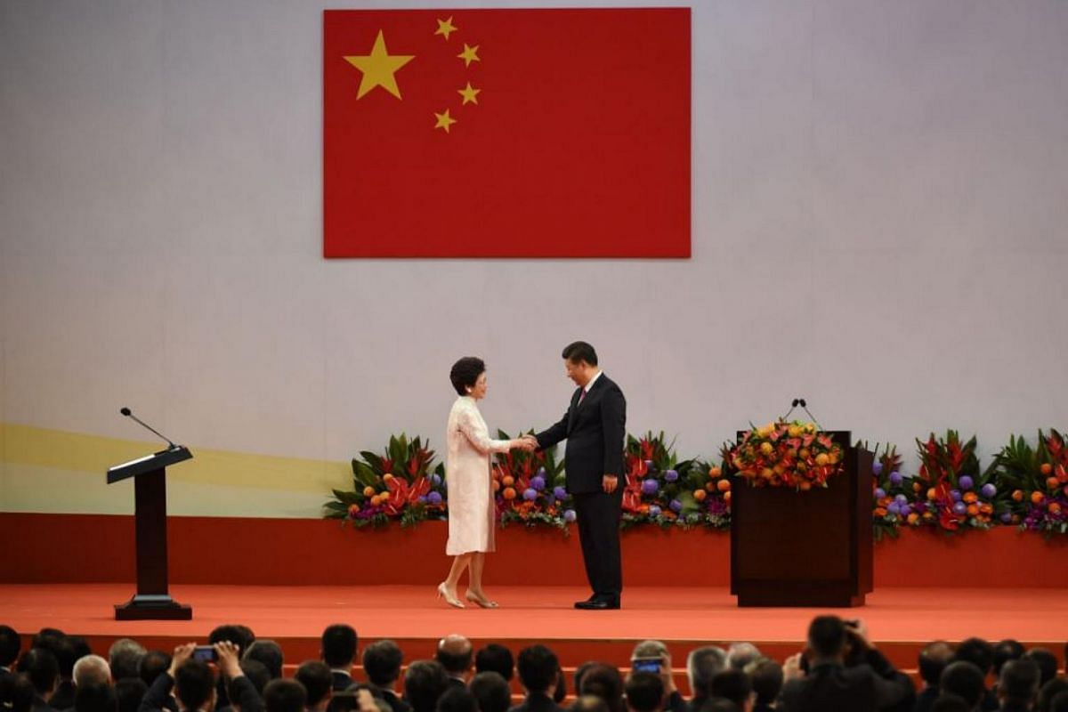 Hong Kong's new Chief Executive Carrie Lam (left) shaking hands with China's President Xi Jinping after being sworn in as the territory's new leader, on July 1, 2017.