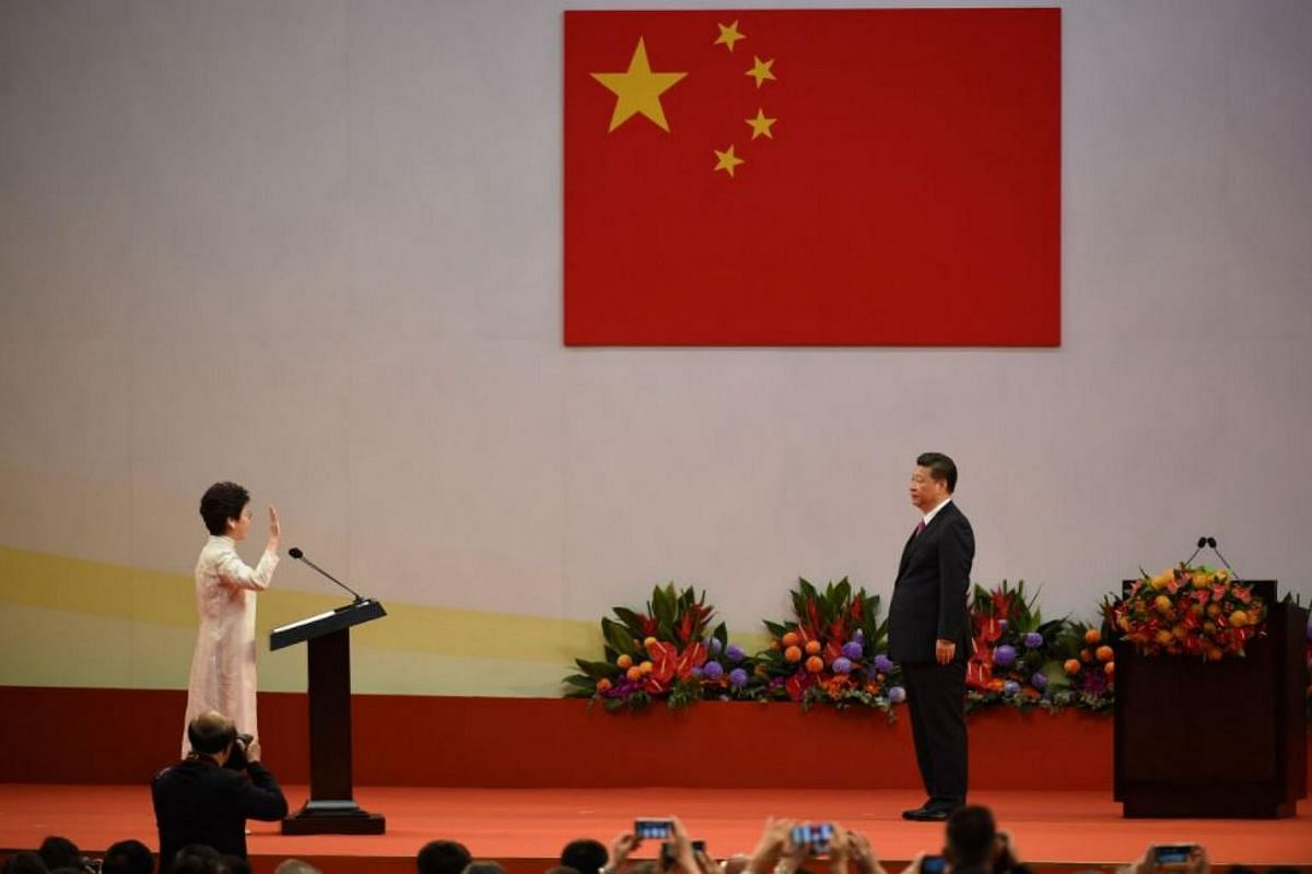Hong Kong's new Chief Executive Carrie Lam (left) faces China's President Xi Jinping (right) as she is sworn in as the territory's new leader at the Hong Kong Convention and Exhibition Centre in Hong Kong on July 1, 2017.
