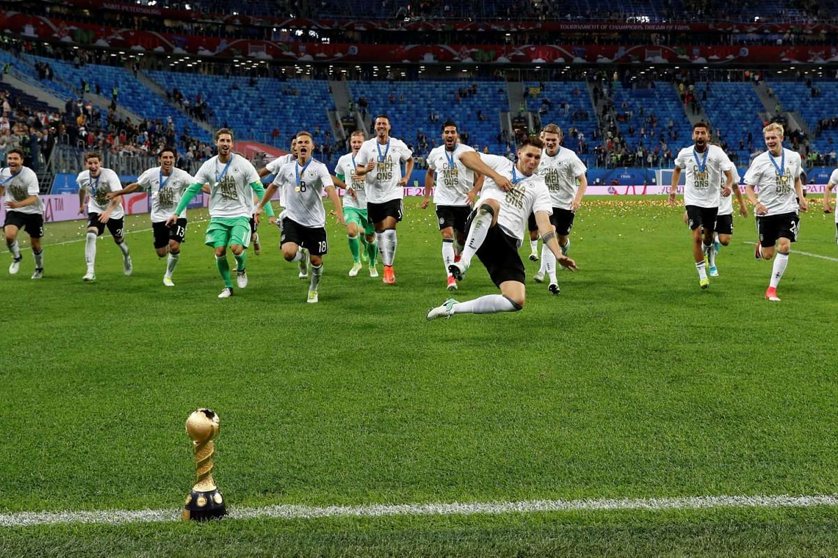 Soccer Football - Chile v Germany - FIFA Confederations Cup Russia 2017 - Final - Saint Petersburg Stadium, St. Petersburg, Russia - July 2, 2017 Germany celebrate with the trophy after winning the FIFA Confederations Cup.