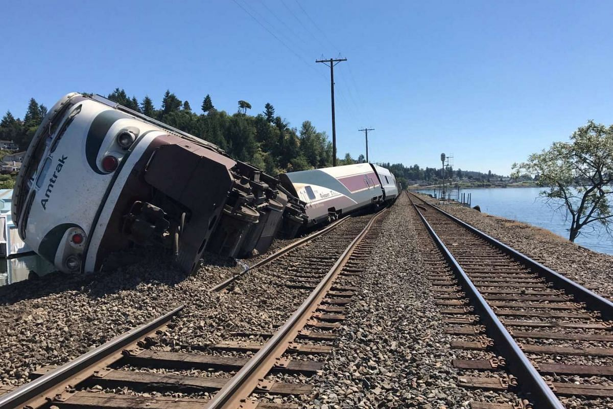 A derailed Amtrak passenger train lies on its side before the Chambers Bay Bridge on Puget Sound in Steilacoom, Washington, U.S. July 2, 2017.