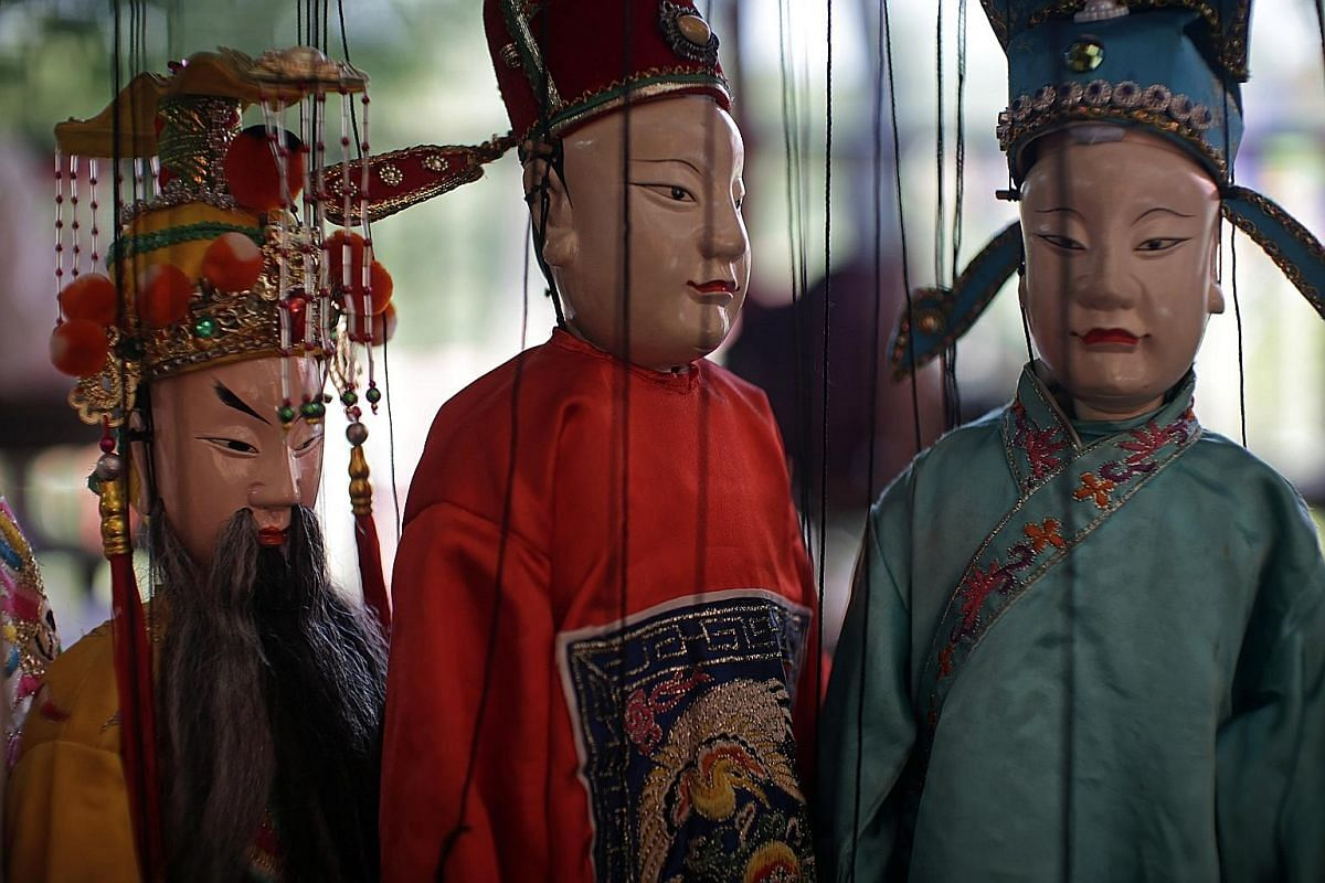 Puppets representing the god Lu (left), which is the God of Status from the Fu Lu Shou trio, and two scholars. The puppets are made in China's Fujian province and can cost a few hundred dollars apiece.