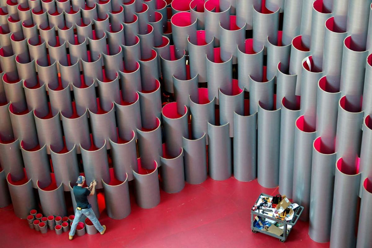 """An install team member works on Studio Gang's """"Hive"""", the latest Summer Block Party interactive installation, at the National Building Museum in Washington, D.C., U.S., July 3, 2017."""