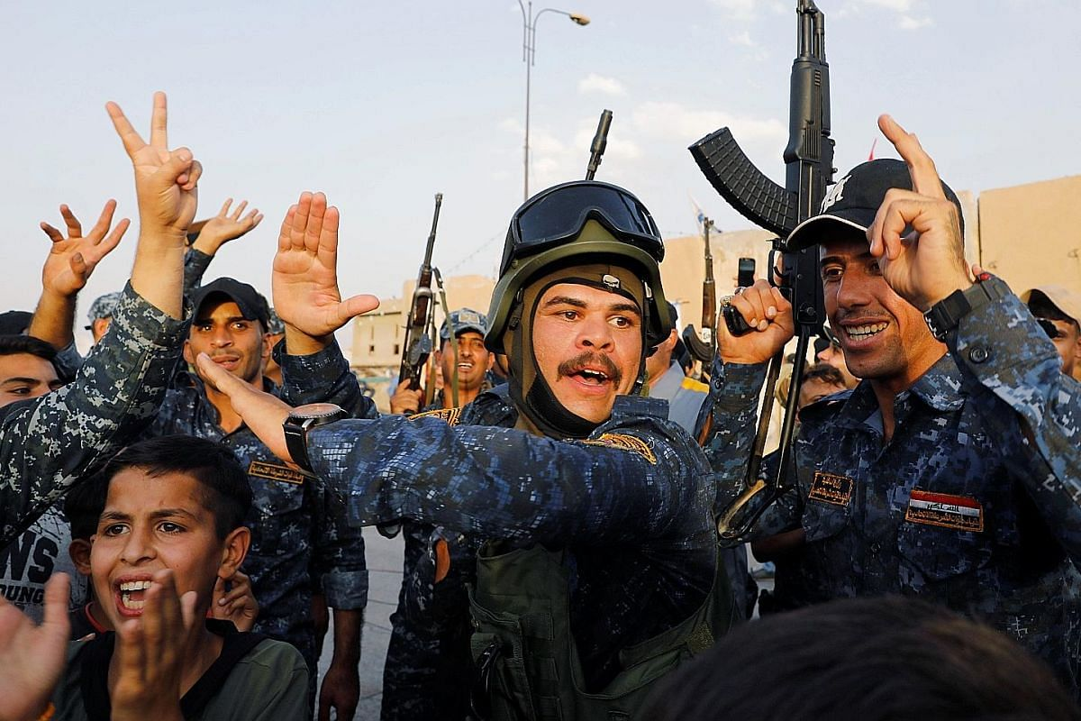 Plenty of joy and cheering as civilians join members of the Iraqi federal police in celebrating victory over ISIS militants in west Mosul.