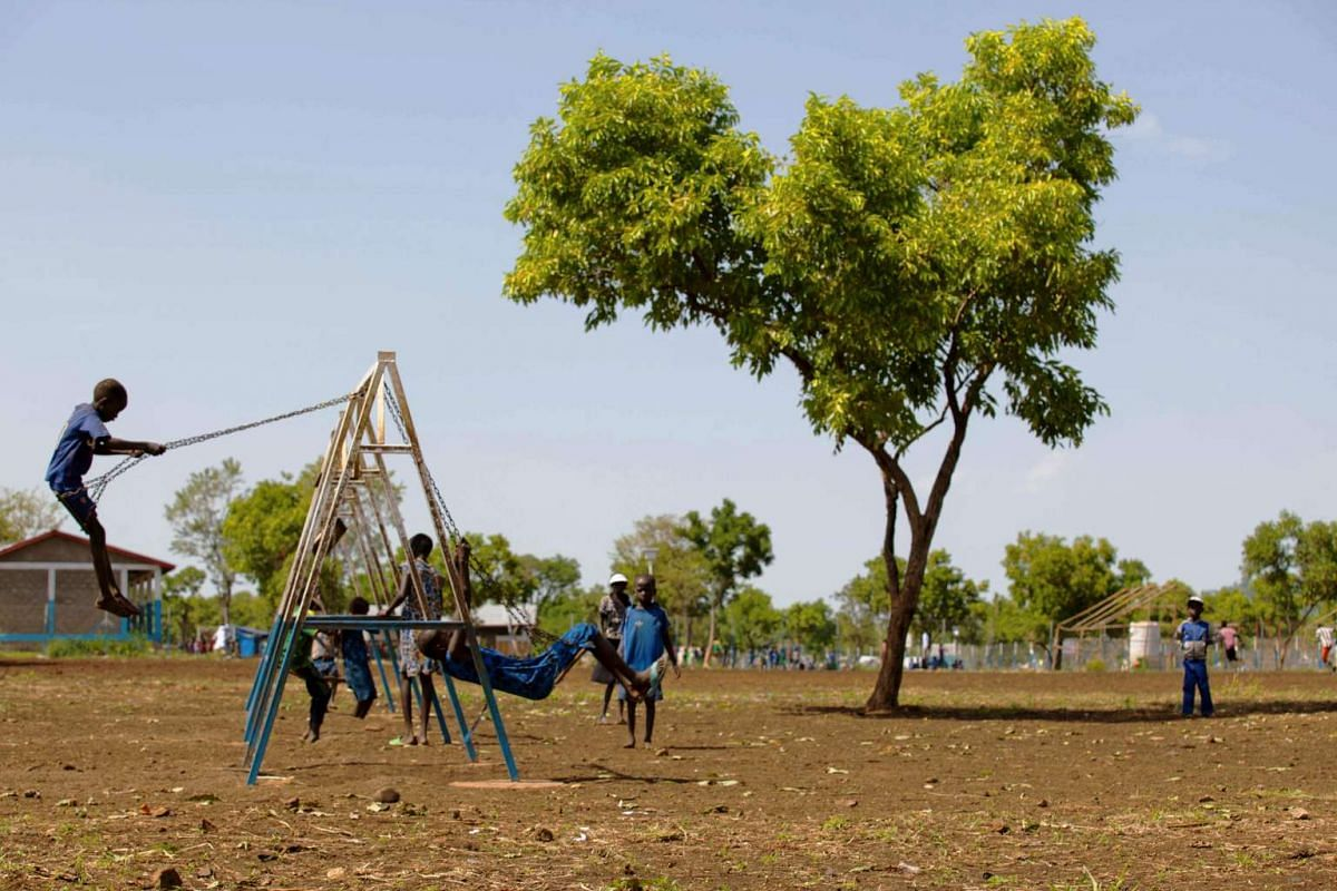 Unaccompanied children who travelled alone alone from South Sudan to the Ethiopian border, play on swings at the children friendly space of Plan International Nguenyyiel refuge camp in Gambela, Ethiopia. Around 1.8 million South Sudanese have fled th