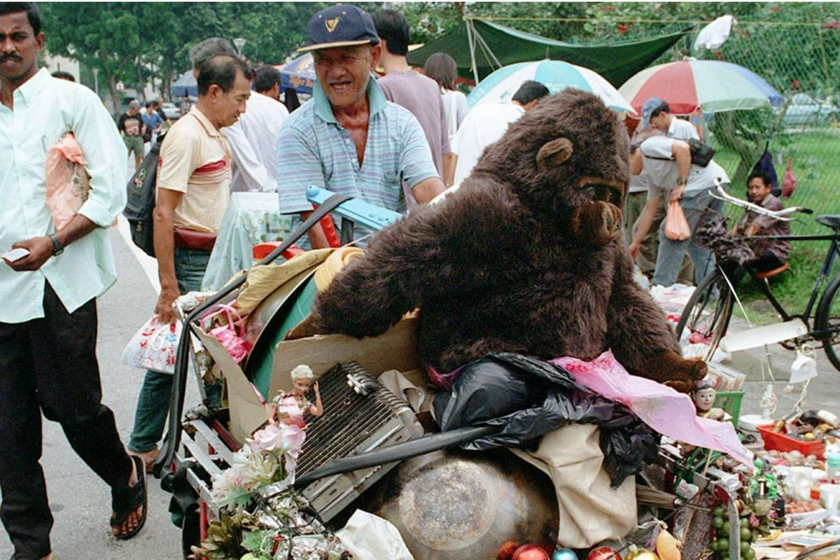 2000: A vendor known as Mr Ah Kim and his tricycle filled with salvaged items. The tricycle not only serves as a mode of transport but also doubles as a showcase.