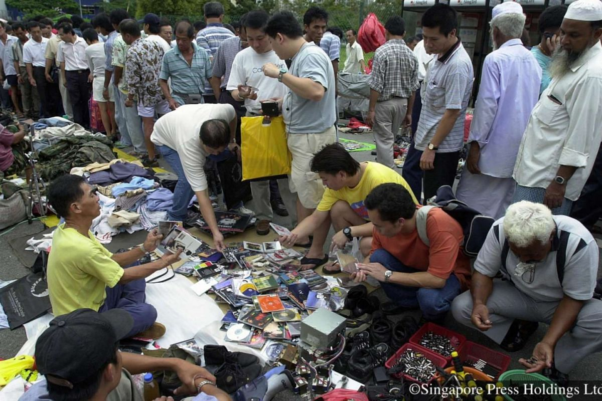 2001: The flea market is a popular hunting ground for vintage items where potential customers, and the curious, check out the eclectic mix of cheap buys.
