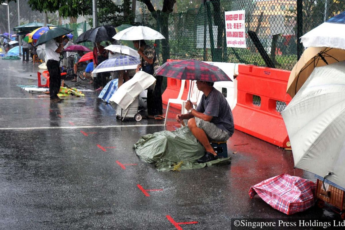 """2011: In the past, odd things were used as """"markers"""" for vendors to unofficially book their spot for spreading out their wares. The Sungei Road hawking zone was reduced to half its regular space on 25 July 2011 with 1m-by-1m spaces marked out in"""