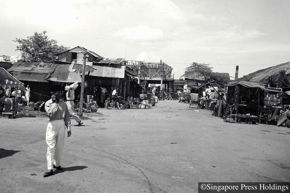 1951: The glory days of the Sungei Road flea market aka Thieves' Market, aka Robinson Petang or Poor Man's Department Store were perhaps in the fifties and sixties. Shoppers and stall-holders haggle all day long over an array of items, including st