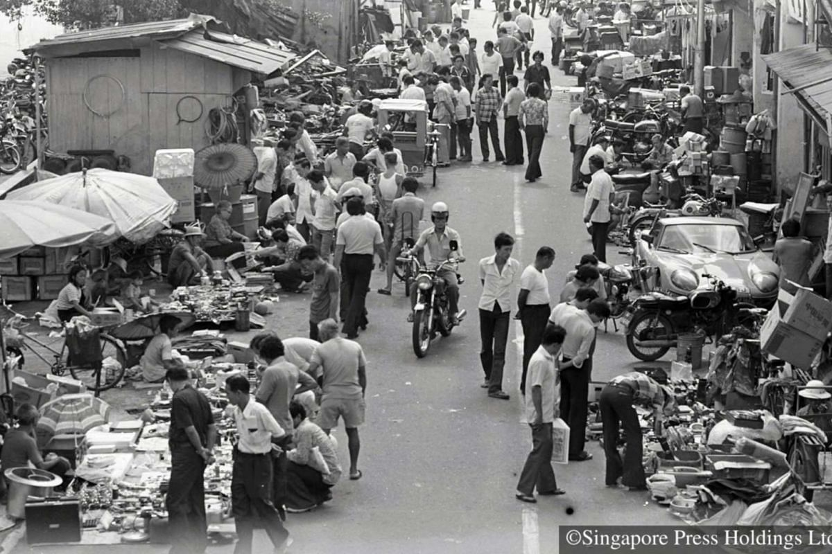 1980: Old world charm and uniquely Singaporean or just a chaos of both human and motor traffic among heaps of second-hand junk?