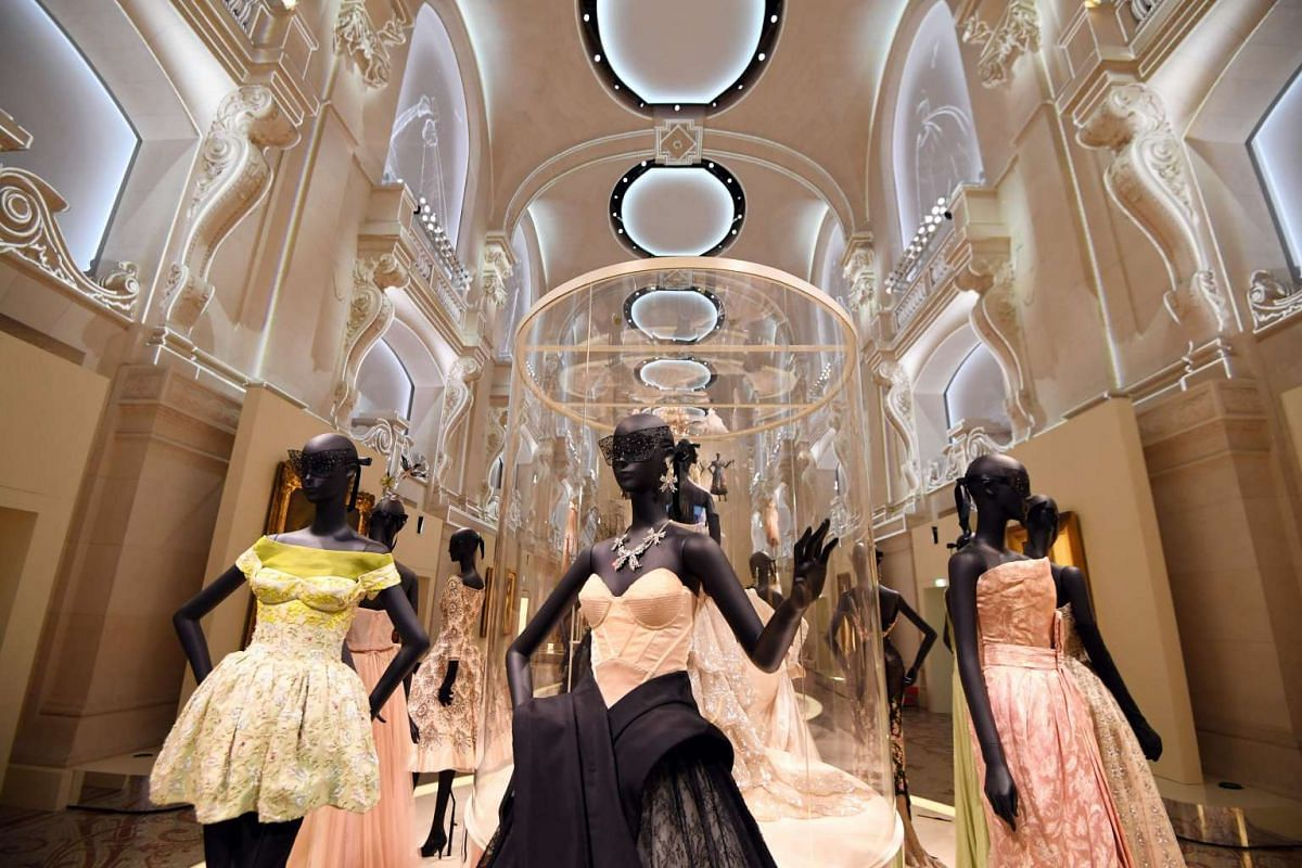 Dresses are pictured during the Dior exhibition that celebrates the 70th anniversary of the Christian Dior fashion house on July 3, 2017 in Paris.