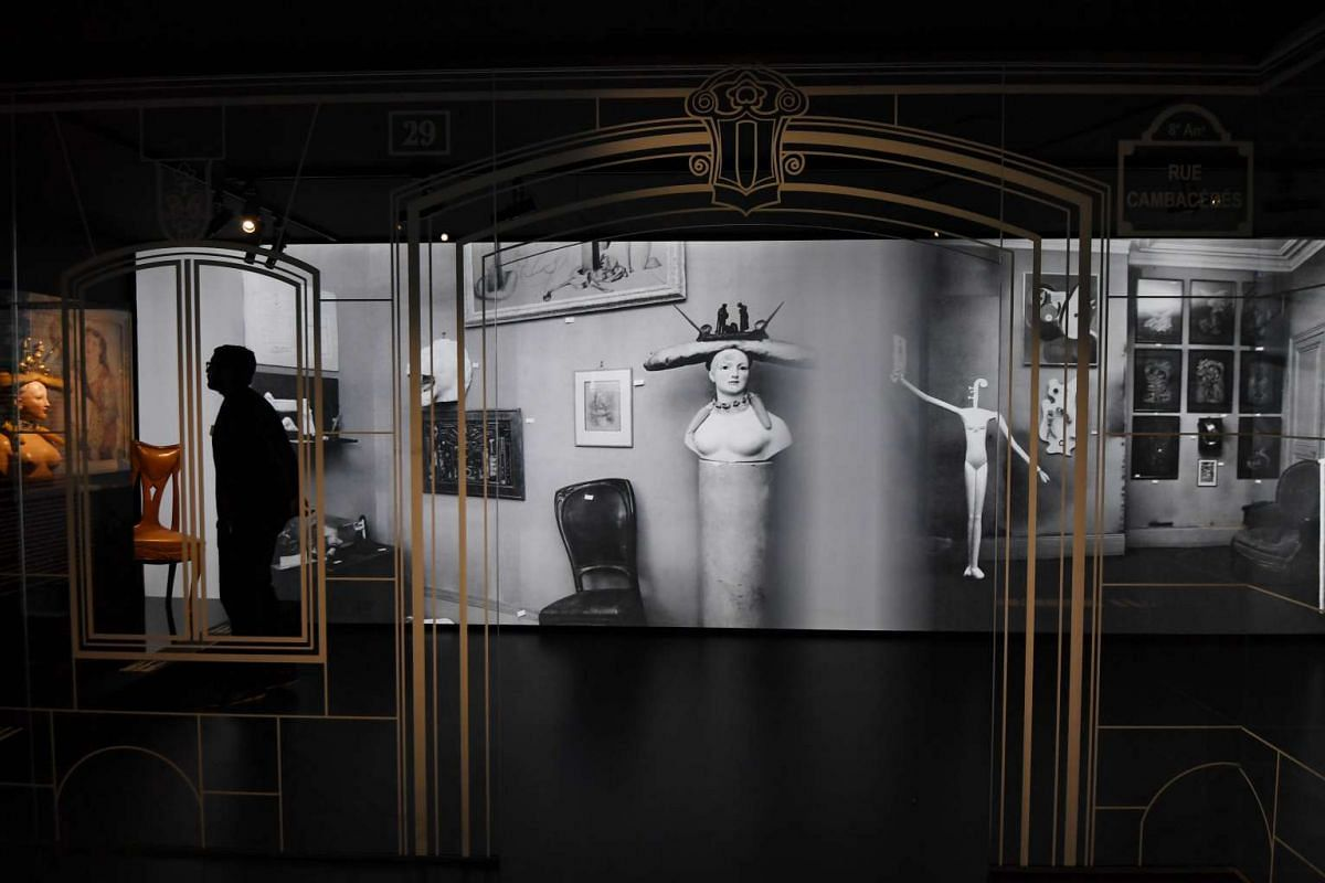 A visitor viewing items during the Dior exhibition that celebrates the 70th anniversary of the Christian Dior fashion house on July 3, 2017 in Paris.