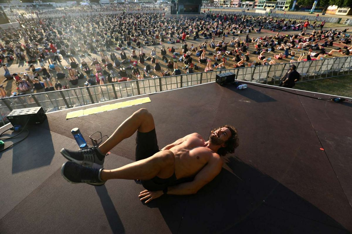 British fitness personality Joe Wicks leads an attempt to break the Guinness World Record for largest High Intensity Interval Workout in Hyde Park in London, Britain July 5, 2017.