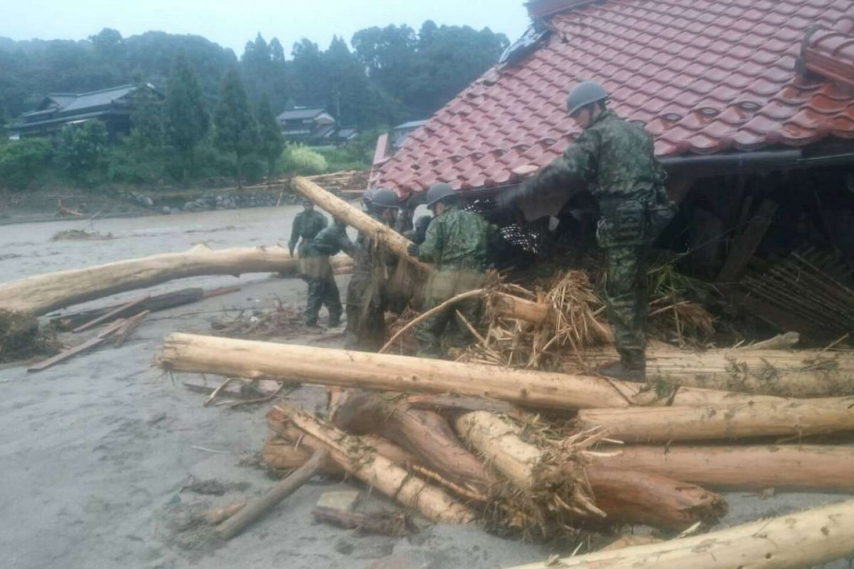 Japan Self-Defense Force (JSDF) soldiers conduct rescue operations after heavy rain hit the area in Asakura, Fukuoka Prefecture, Japan July 6, 2017.