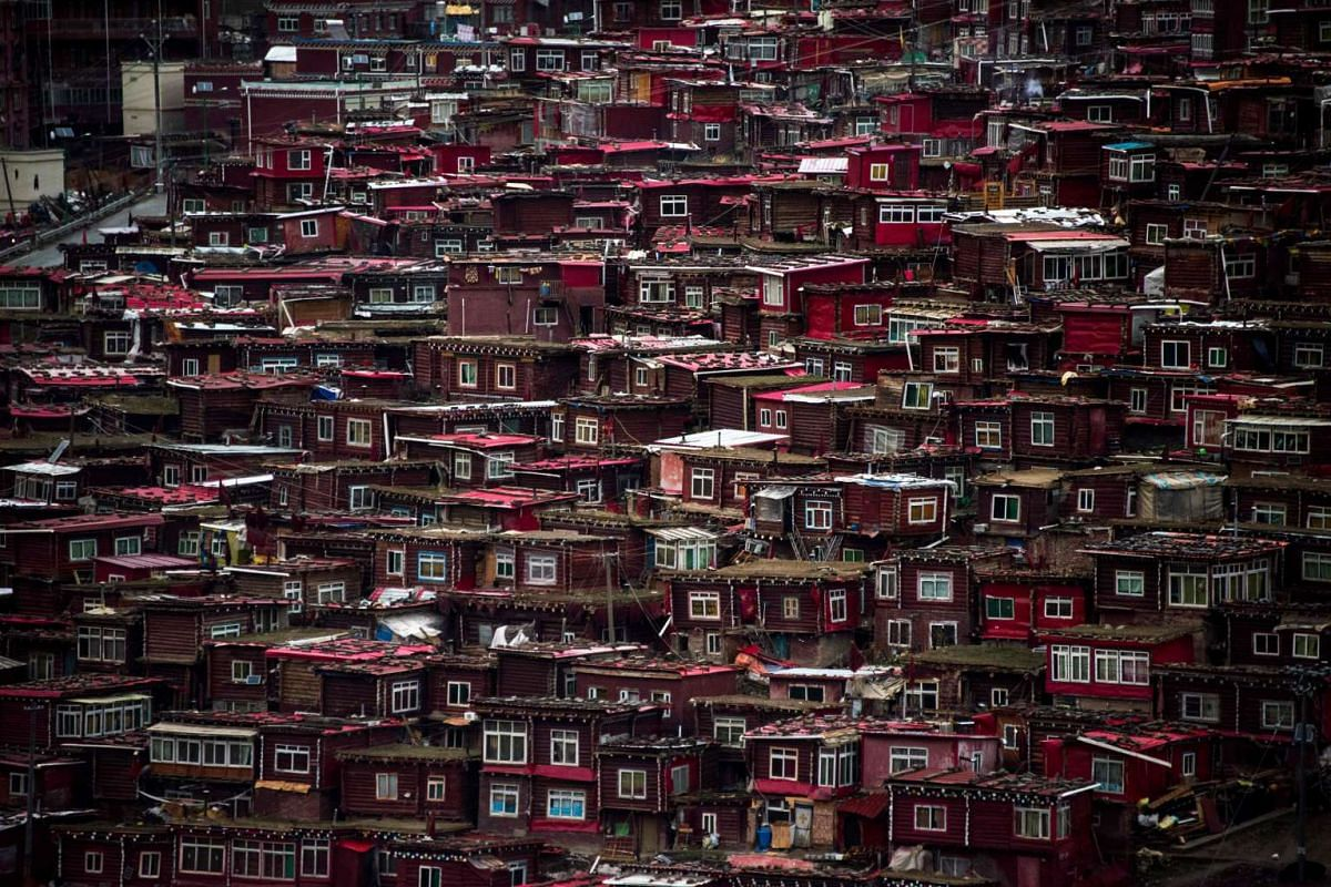 Thousands of monks, nuns and laypeople -- including many Han Chinese devotees -- crowd this remote valley in Sichuan province to study at Larung Gar, the world's largest and most important institution for Tibetan Buddhist learning. But authorities ha