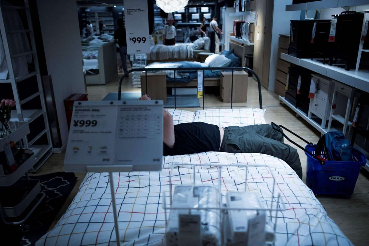 A man resting in an Ikea store in downtown Shanghai on July 5, 2017. The city's meteorological bureau recorded a high of 36.2 deg C, a local newspaper reported.