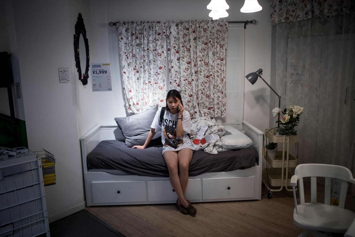 A woman relaxing on a bed in an Ikea store in Shanghai on July 5, 2017, when temperatures hit 36.2 deg C, a local newspaper reported.