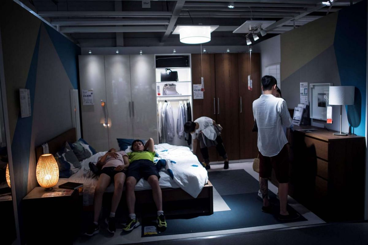 People relaxing in an Ikea store in downtown Shanghai during the summer heat on July 5, 2017.