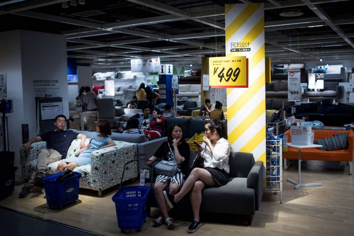 People relaxing on sofas in an Ikea store in downtown Shanghai on July 5, 2017, when the city's meteorological bureau recorded a high of 36.2 deg C, a local newspaper reported.