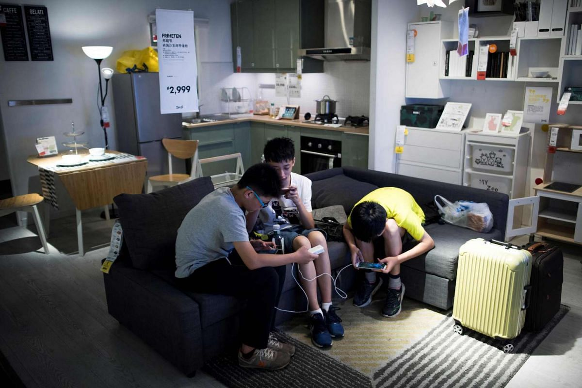 Three boys escaping the summer heat in an Ikea store in downtown Shanghai on July 5, 2017, when the city's meteorological bureau recorded a high of 36.2 deg C, according to a local newspaper.