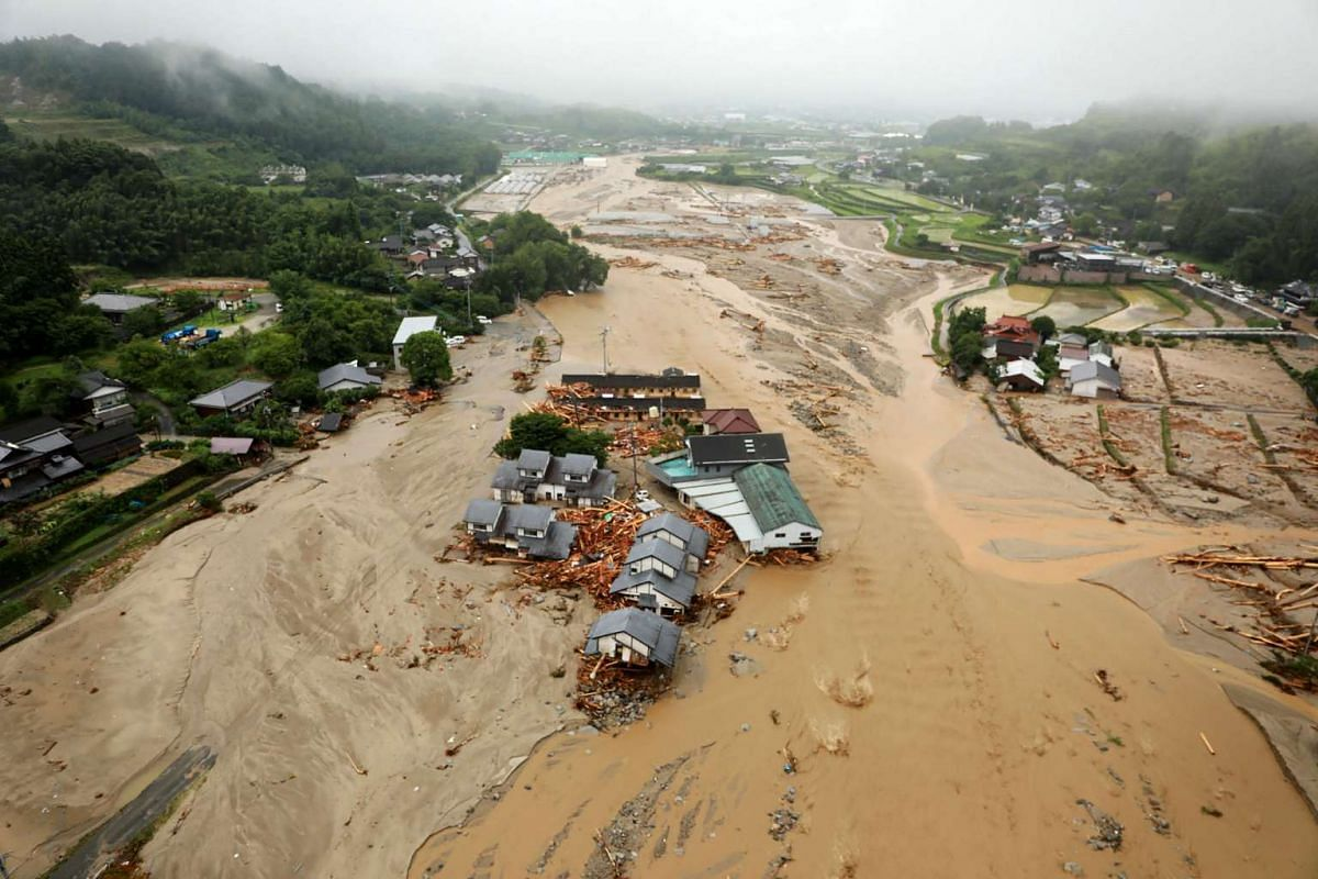 An areal view of flooded Asakura City, Fukuoka prefecture, on July 6, 2017.One person reportedly died and at least 18 are missing, after huge floods swept away houses in southern Japan, tearing up roads as they surged through villages, with authoriti