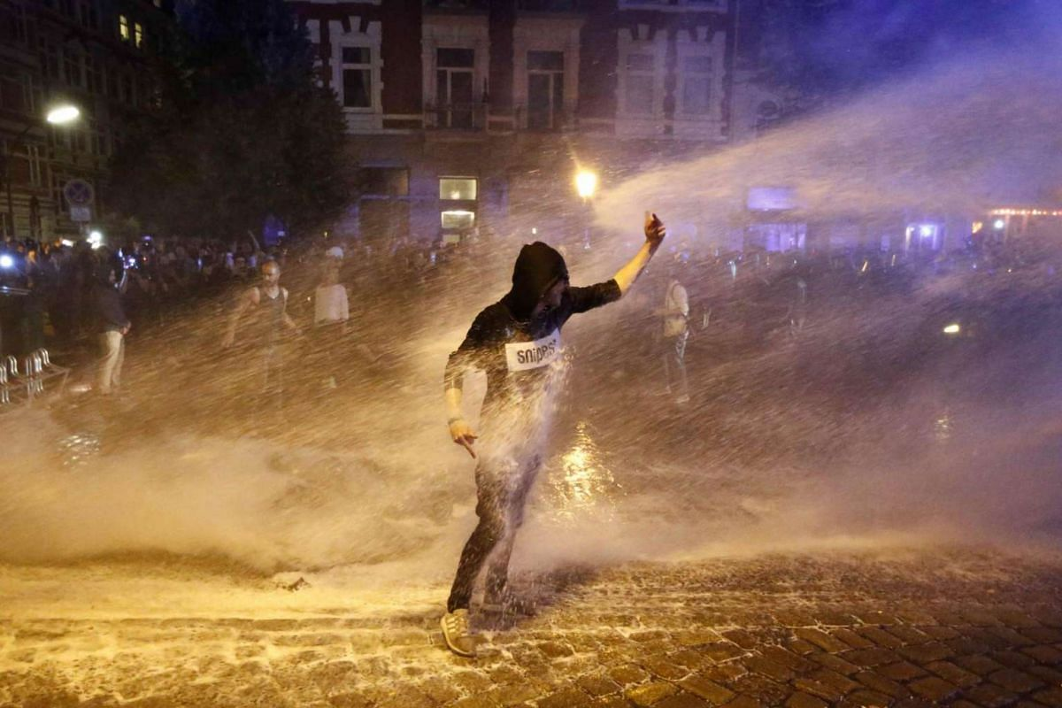 A police water cannon spraying a protester during the demonstrations during the G-20 summit in Hamburg, Germany, on July 6, 2017.