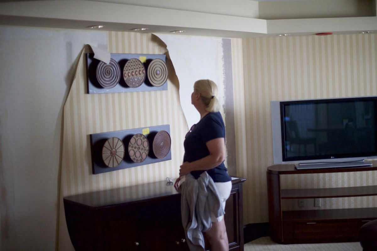 Ms Lindsay Hood looking at artwork for sale at the former Trump Taj Mahal casino during a liquidation sale in Atlantic City, New Jersey, on July 6, 2017.