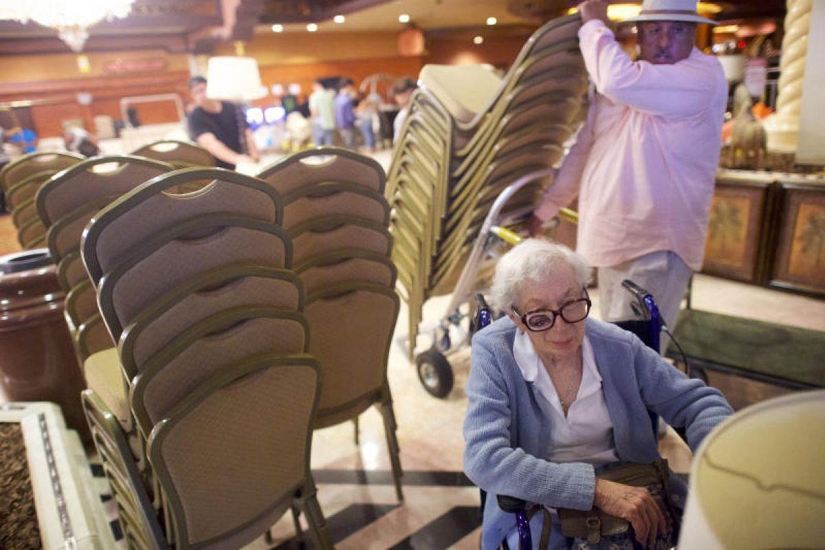 Ms Valerie Biron waits to load her purchased lamps during the liquidation sale of the former Trump Taj Mahal casino in Atlantic City, New Jersey, on July 6, 2017.