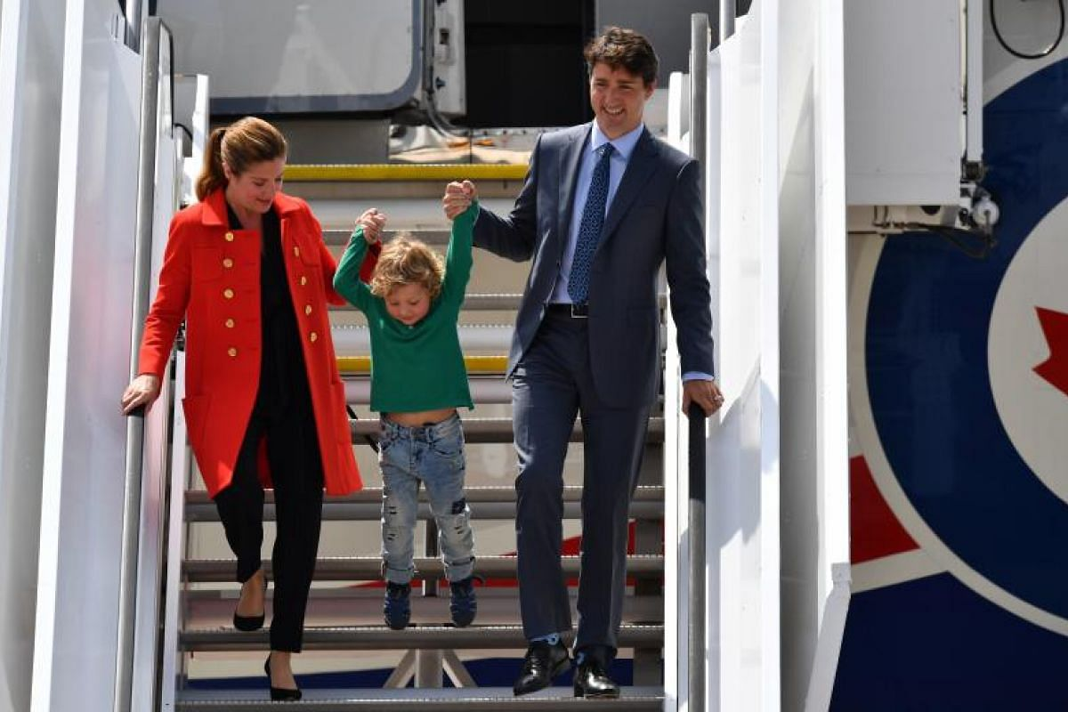Canada's Prime Minister Justin Trudeau and his wife Sophie Gregoire Trudeau giving their eager young son Hadrien an early introduction to international politics as they arrive in Hamburg for the G-20 summit.