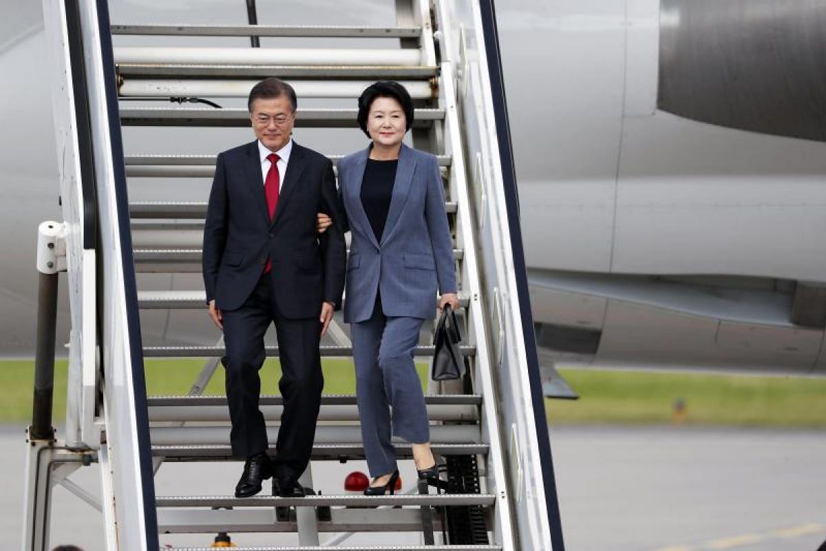 South Korea's President Moon Jae In and his wife Kim Jung Sook arriving at Hamburg airport. Prior to the G-20 summit, Mr Moon had called for toughened sanctions against North Korea in the wake of its latest missile test.