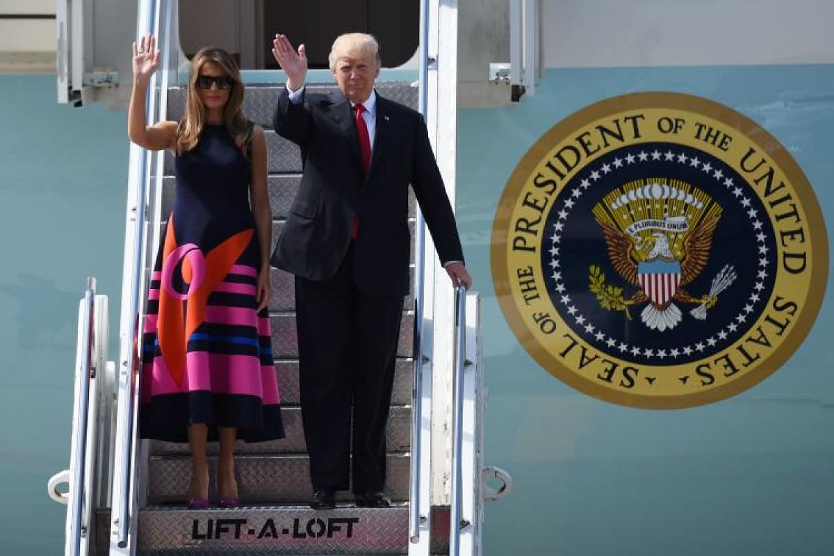 US President Donald Trump and his wife Melania Trump on the steps of Air Force One at Hamburg's airport. This year's G-20 summit is likely to feature heated discussions on issues ranging from wars and terrorism to climate change and global trade.