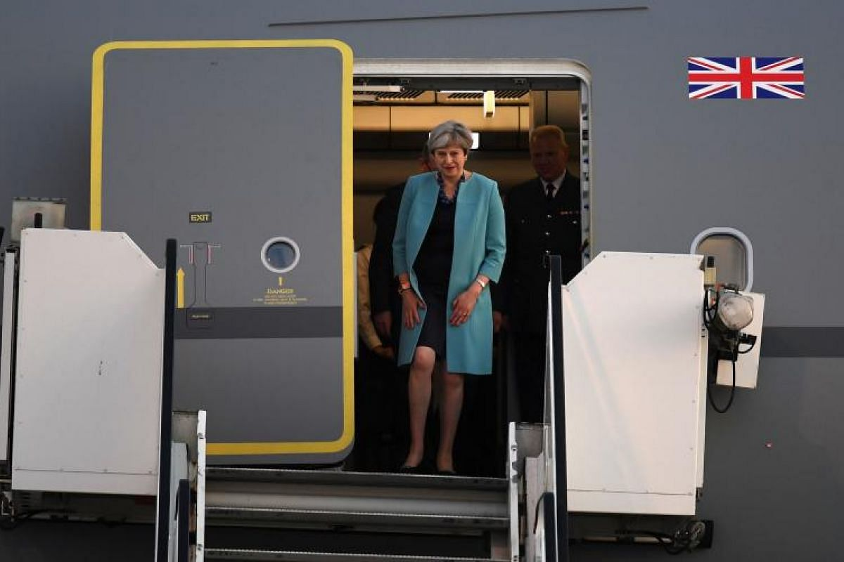 Britain´s Prime Minister Theresa May and her husband Philip May about to disembark their plane. Mrs May is entering the G-20 talks claiming that her priority is to disrupt terrorist groups from accessing finance, The Guardian has reported.