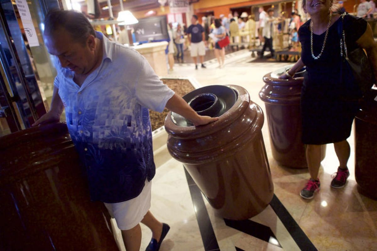 Mr Paul Miguel dragging away two garbage cans he purchased for US$40 (S$55) during the liquidation sale of the former Trump Taj Mahal casino in Atlantic City, New Jersey, on July 6, 2017.