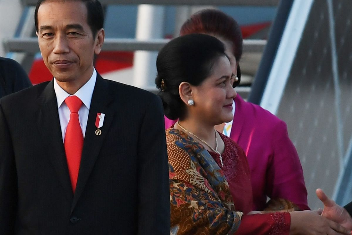 Indonesia's President Joko Widodo and his wife Iriana Widodo on the tarmac of Hamburg airport. Mr Joko is expected to speak on counterterrorism during the G-20 leaders' retreat on Friday (July 7), as well as attend a working session on sustainable de