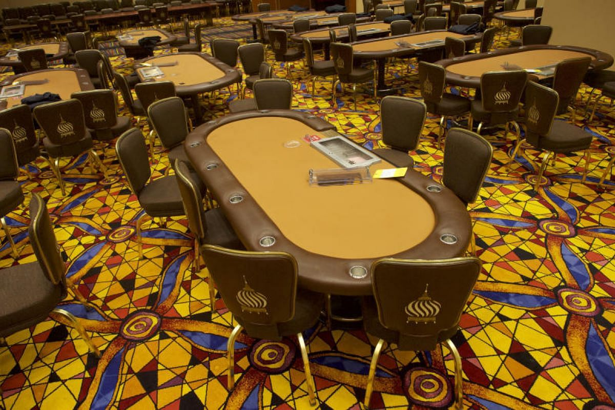 Poker tables at the former Trump Taj Mahal casino liquidation sale in Atlantic City, New Jersey, on July 6, 2017.